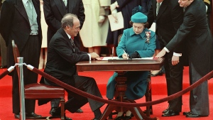 Queen Elizabeth II signs Canada's constitutional proclamation in Ottawa on April 17, 1982 as Prime Minister Pierre Trudeau looks on. (CP PHOTO/Ron Poling)