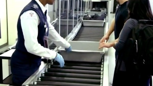 Passengers go through security at Toronto's Pearson International Airport.