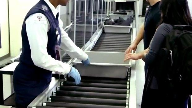 Passengers go through security at Toronto's Pearson International Airport.