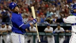 Toronto Blue Jays' Steve Pearce, left, reacts to striking out with the bases loaded as Texas Rangers catcher Jonathan Lucroy throws the ball back to relief pitcher Jose Leclerc during the seventh inning of a baseball game, Tuesday, June 20, 2017, in Arlington, Texas. (AP Photo/Tony Gutierrez)