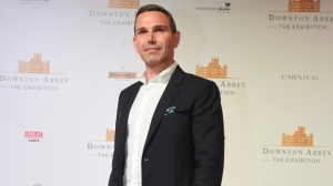 Michael Edelstein, President of NBCUniversal International studios, poses on the red carpet at the launch of an exhibition about television series Downton Abbey at the Marina Bay Sands on Wednesday, June 21, 2017 in Singapore. (AP Photo/Joseph Nair)