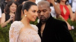 Kim Kardashian, left, and Kanye West arrive at The Metropolitan Museum of Art's Costume Institute benefit gala in New York. Kardashian posted a tribute to West on Instagram to mark the couple's second wedding anniversary on May 24, 2016. (Photo by Charles Sykes/Invision/AP, File)