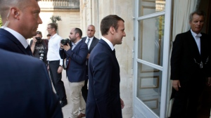 French President Emmanuel Macron, center, leaves after the family photo session prior to the first cabinet meeting at the Elysee Palace in Paris, Thursday, June 22, 2017. Macron brought several little-known figures into his government Wednesday as part of a reshuffle after corruption scandals started tarnishing his young Cabinet. (AP Photo/Thibault Camus)