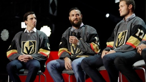 Vegas Golden Knights' Marc-Andre Fleury, Deryk Engelland and Brayden McNabb, from left, sit on stage during an event following the NHL expansion draft, Wednesday, June 21, 2017, in Las Vegas. The players were picked by the Golden Knights in the NHL expansion draft. (AP Photo/John Locher)
