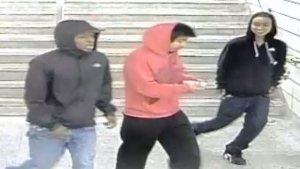 Three suspects in a street robbery in the city's Dovercourt Park neighbourhood are shown in a surveillance camera image. (Toronto Police Service)