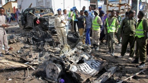 Somali security forces gather at the scene of a suicide car bomb attack on a police station in Mogadishu, Somalia Thursday, June 22, 2017. A number of people are dead and several others wounded in the blast in Somalia's capital, police said Thursday, adding that the bomber was trying to drive into the police station's gate but detonated against the wall instead. (AP Photo/Farah Abdi Warsameh)