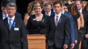 The casket of Otto Warmbier is carried from Wyoming High School followed by his father, Fred Warmbier, center, after the funeral, Thursday, June 22, 2017, in Wyoming, Ohio. Otto Warmbier, a 22-year-old University of Virginia undergraduate student who was sentenced in March 2016 to 15 years in prison with hard labor in North Korea, died this week, days after returning to the United States. (AP Photo/Bryan Woolston)