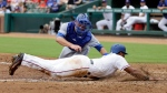 Toronto Blue Jays catcher Luke Maile tags out Texas Rangers' Elvis Andrus, who was trying to score on a fielder's choice hit into by Adrian Beltre, during the third inning of a baseball game, Thursday, June 22, 2017, in Arlington, Texas. (AP Photo/Tony Gutierrez)