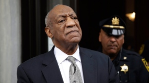In this Saturday, June 17, 2017, file photo, Bill Cosby exits the Montgomery County Courthouse after a mistrial was declared in his sexual assault trial in Norristown, Pa. Judge Steven O'Neill who presided over Cosby's sexual assault trial is weighing whether to make public the identities of the jurors who deadlocked in the case. He said he would rule by Wednesday, June 21. (AP Photo/Matt Rourke)
