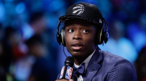 Indiana's OG Anunoby answers questions during an interview after being selected by the Toronto Raptors as the 23rd pick overall during the NBA basketball draft, Thursday, June 22, 2017, in New York. (AP Photo/Frank Franklin II)