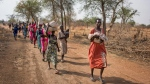In this Wednesday, April 5, 2017 file photo, some of thousands of people walk for hours to reach a food distribution site in Malualkuel, in the Northern Bahr el Ghazal region of South Sudan. South Sudan no longer has areas in famine, but almost 2 million people are on the brink of starvation and an estimated 6 million people - half the population - will face extreme food insecurity between June and July, according to reports by the government and the United Nations released Wednesday, June 21, 2017. (AP Photo, File)