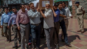 Indian police officers in plain clothes carry the coffin of Mohammad Ayoub Pandit, a policeman who was beaten to death, during a ceremony at the police headquarters in Srinagar, Indian controlled Kashmir, Friday, June 23, 2017. Police and witnesses say an officer in Indian-controlled Kashmir's main city has been beaten to death after he fired at a group of people who suspected him of spying on worshippers during the holiest night of the year for Muslims. (AP Photo/Dar Yasin)