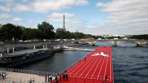 A floating race track is set up on the Seine river in Paris, Friday, June 23, 2017. Paris is aiming to boost its bid for the 2024 Olympics by turning some of its world-famous landmarks over to sports for two days, with 100-meter races on a track floating on the Seine, high-diving into the river, cycling around the Arc de Triomphe and other events to showcase the French capital's suitability for the games. (AP Photo/Thibault Camus)