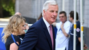 The EU chief Brexit negotiator Michel Barnier, right, arrives for an EPP meeting in Brussels on Thursday, June 22, 2017. European Union leaders are gathering prior to a a two day summit to weigh measures in which to tackle terrorism and migration and to create closer defense ties. (AP Photo/Geert Vanden Wijngaert)