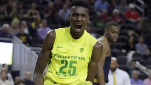 Oregon's Chris Boucher reacts after scoring against California during the first half of an NCAA college basketball game in the semifinals of the Pac-12 tournament Friday, March 10, 2017, in Las Vegas. THE CANADIAN PRESS/AP Photo/John Locher