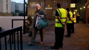 Residents are evacuated from the Taplow residential tower block on the Chalcots Estate, in the borough of Camden, north London, Friday, June 23, 2017. (AP Photo/Alastair Grant)