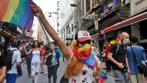 People protests against the ban on a gay pride march, off Istiklal Avenue, central Istanbul's main shopping road, Sunday, June 19, 2016. (AP Photo/ Emrah Gurel)