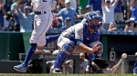 Kansas City Royals' Alcides Escobar beats the tag by Toronto Blue Jays catcher Luke Maile to score on a triple by Alex Gordon during the seventh inning of a baseball game Saturday, June 24, 2017, in Kansas City, Mo. (AP Photo/Charlie Riedel)