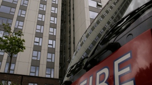 A fire engine is parked outside Burnham block, part of the Chalcots Estate in the borough of Camden, north London, Saturday June 24, 2017, after the local council evacuated some 650 homes overnight. (AP Photo/Alastair Grant)