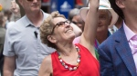 Prime Minister Justin Trudeau and Ontario Premier Kathleen Wynne wave to the crowd at the Pride parade in Toronto, Sunday, June 25, 2017 as Trudeau's children Xavier and Ella-Grace look on. THE CANADIAN PRESS/Mark Blinch