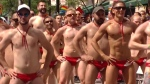 A group of men dance in the Toronto Pride Parade Sunday June 25, 2017.