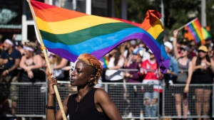 A woman holds a flag during the Pride parade in Toronto, Sunday, June 25, 2017. THE CANADIAN PRESS/Mark Blinch