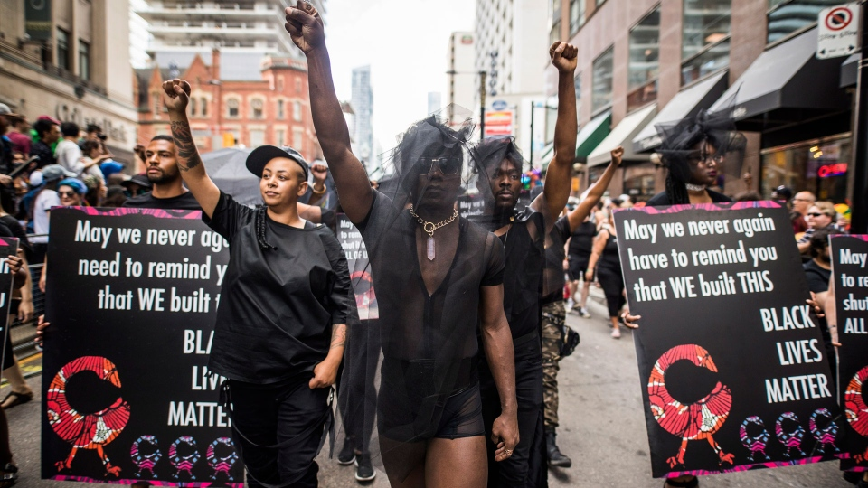 People from the Blacks Lives Matter movement march during the Pride parade in Toronto, Sunday, June 25, 2017. THE CANADIAN PRESS/Mark Blinch
