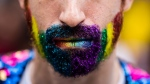A man has his face painted during the Pride parade in Toronto, Sunday, June 25, 2017. THE CANADIAN PRESS/Mark Blinch