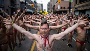 People take part in the Pride parade in Toronto, Sunday, June 25, 2017. THE CANADIAN PRESS/Mark Blinch