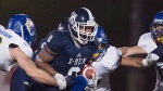St. Francis Xavier X-Men Ashton Dickson scrambles with the ball against the UBC Thunderbirds in first half of Uteck Bowl action in Antigonish, N.S. on Saturday, Nov. 21, 2015. THE CANADIAN PRESS/Andrew Vaughan