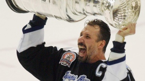 Tampa Bay Lightning captain Dave Andreychuk hoists the Stanley Cup after the Lightning defeated the Calgary Flames 2-1 in Game 7 to win the NHL Stanley Cup Finals in Tampa, Fla., Monday, June 7, 2004. (Gene J. Puskar/The Canadian Press)