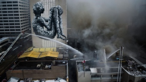 Firefighters battle a six-alarm fire at a racquet club at the intersection of Yonge St. and St.Clair Ave. West, in Toronto on Tuesday, February 14, 2017. (Christopher Katsarov/The Canadian Press)