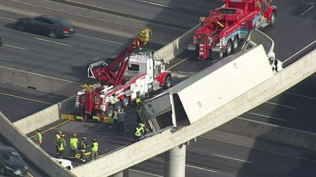 Eastbound Hwy  401 lanes reopen after transport truck tips, hovers
