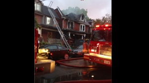Toronto Fire is on the scene of a two-alarm blaze on Booth Avenue. (Cam Woolley/ CP24)