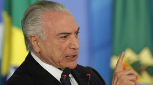 """Brazil's President Michel Temer speaks during a ceremony at the Planalto Presidential Palace, in Brasilia, Monday, June 26, 2017. Temer is expressing defiance in the face of possible corruption charges, the lowest approval rating for a Brazilian leader in a generation and calls for his resignation. He says nothing will """"destroy"""" his government. (AP Photo/Eraldo Peres)"""
