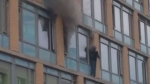 A man stands on the third-floor ledge of a downtown high-rise during a fire on June 27, 2017. (Video/photo provided by Orlando Clemente)