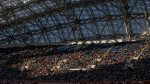 In this Sunday, June 25, 2017 file photo, spectators sit in the stands during the Confederations Cup, Group B soccer match between Germany and Cameroon, at the Fisht Stadium in Sochi, Russia. After years of controversy, Russian officials think their World Cup has weathered the storm. Questions have receded over the legitimacy of the 2010 vote that gave Russia the tournament, the stadiums are either finished or nearing completion, and the Confederations Cup is going smoothly.(AP Photo/Thanassis Stavrakis/File)