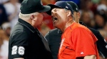 Boston Red Sox manager John Farrell, right, argues with third base umpire Bill Miller after a called balk during the seventh inning of a baseball game against the Los Angeles Angels, Saturday, June 24, 2017, in Boston. Farrell was ejected. (AP Photo/Michael Dwyer)