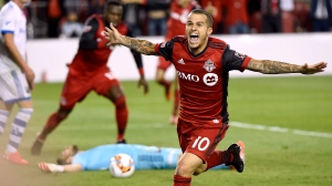 Toronto FC forward Sebastian Giovinco (10) celebrates his game-winning goal in second half Canadian Championship soccer action against the Montreal Impact, in Toronto on Tuesday, June 27, 2017. (Nathan Denette/The Canadian Press)