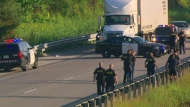 Heavy police presence is seen on Highway 400.