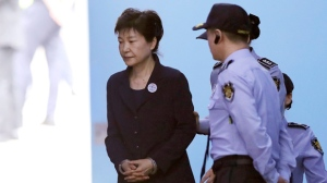 In this Tuesday, May 23, 2017, photo, former South Korean President Park Geun-hye leaves after her trial at the Seoul Central District Court in Seoul, South Korea. (AP Photo/Lee Jin-man, File)