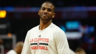 In this March 20, 2017, file photo, Los Angeles Clippers guard Chris Paul warms up before the team's NBA basketball game against the New York Knicks, in Los Angeles. The Houston Rockets have reached an agreement to trade for Los Angeles Clippers point guard Chris Paul according to a person familiar with the deal. The league source spoke to The Associated Press on Wednesday, June 28, 2017, on the condition of anonymity because the team hasn't finalized the trade. (AP Photo/Ryan Kang, File)