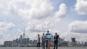 Prime Minister Justin Trudeau announces funding for flood protecting the Port Lands as Premier Kathleen Wynne, Mayor John Tory and Waterfront Toronto CEO William Fleissig look on. (Government of Canada)