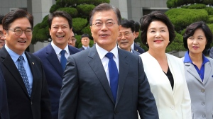 South Korean President Moon Jae-in, center, arrives to leave for the United States at the Seoul military airport in Seongnam, South Korea, Wednesday, June 28, 2017. (Ahn Young-joon/AP Photo)