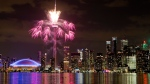 Fireworks explode over the Toronto skyline in this file photo. (AP Photo/Rebecca Blackwell)