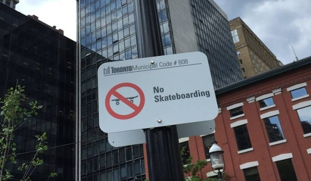 The city has put up signs in Berczy Park that indicate no skateboarding is allowed. (Friends of Berczy Park/Facebook)