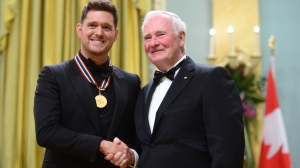 Governor General David Johnston presents Michael Buble with the National Arts Centre Award during the Governor General's Performing Arts Awards ceremony at Rideau Hall in Ottawa on Wednesday, June 28, 2017. (Sean Kilpatrick/The Canadian Press)