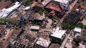 This Oct. 15, 2002 file photo shows bomb wreckage from the Sari night club and surrounding buildings in Kuta, Bali. (Achmad Ibrahim/AP Photo)