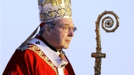 In this July 15, 2008, file photo, Cardinal George Pell walks onto the stage for the opening mass for World Youth Day in Sydney, Australia. (Rick Rycroft/AP Photo)