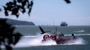 A Canadian Coast Guard hovercraft travels on the waters of English Bay in Vancouver, B.C., on Saturday June 13, 2015. THE CANADIAN PRESS/Darryl Dyck